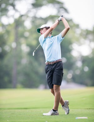 David Chavez tees off on a par 3 during the A. Downing Gray Cup golf tournament at Pensacola Country Club in Pensacola on Tuesday, August 4, 2020.