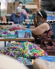 Pam White sorts a shipment of beads for repackaging Tuesday at Pollak Industries in Pensacola. Pollak Industries is the manufacturing division of The Arc Gateway.
