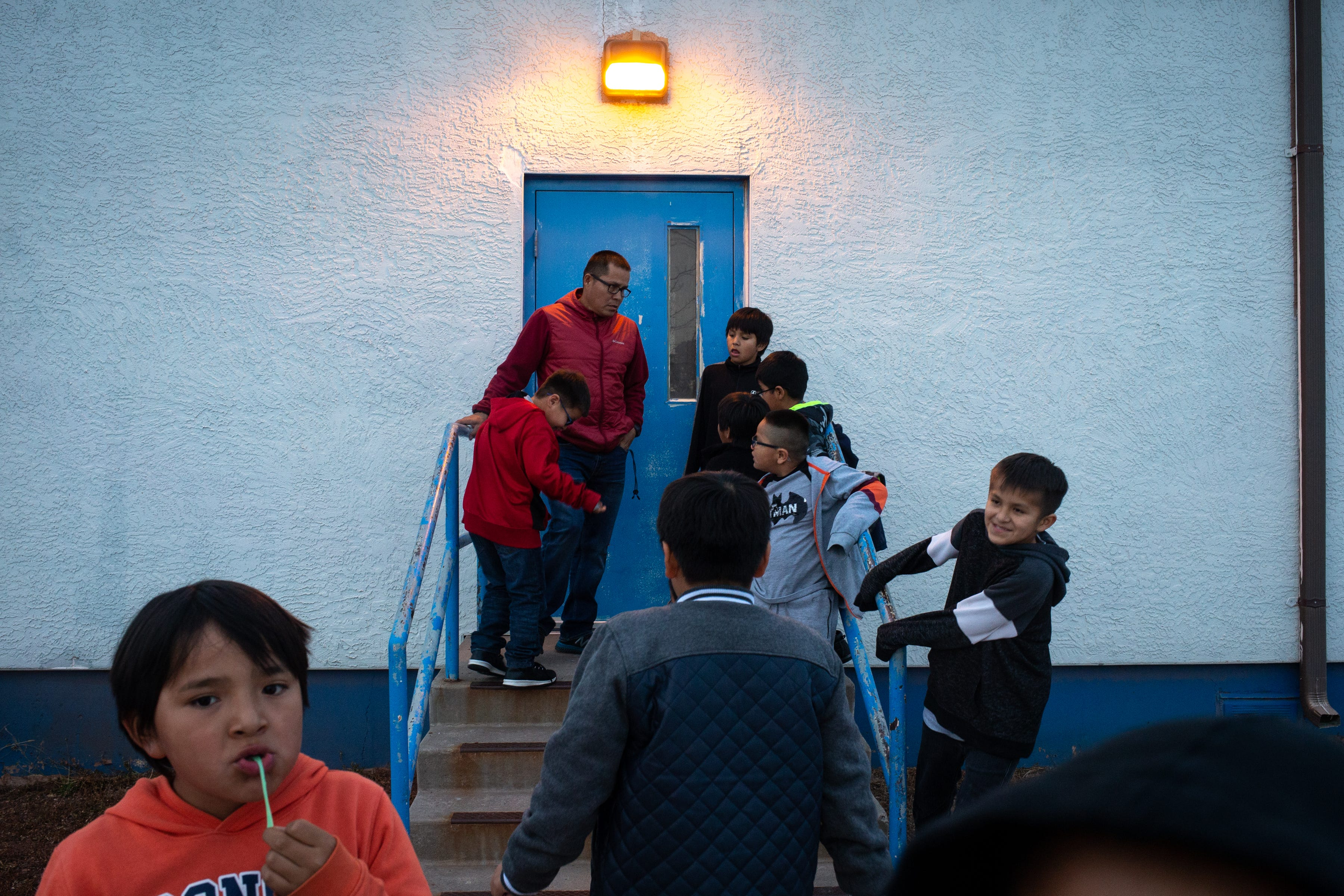 Students line up outside a dorm at Hunters Point Boarding School in St. Michaels, Arizona.