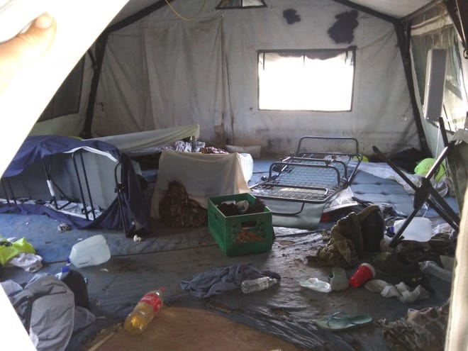 Volunteers with the humanitarian aid group No More Deaths began to evaluate damaged and destroyed items, including medications, during a Border Patrol raid on Friday night.