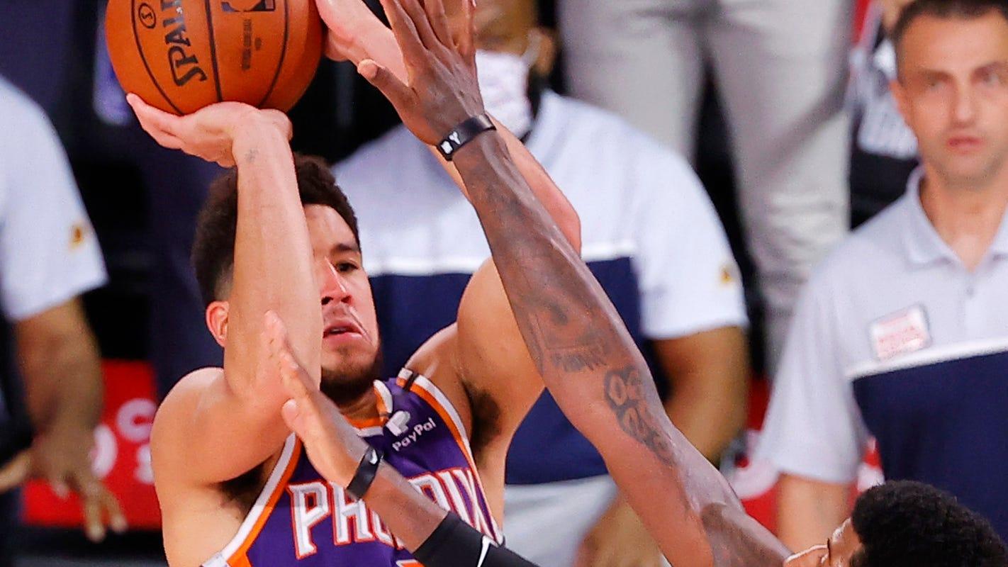 Phoenix Suns stun Los Angeles Clippers on Booker buzzer beater to remain unbeaten in NBA restart
