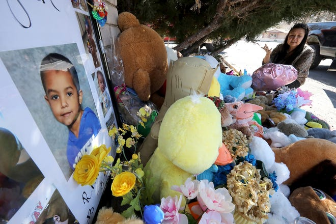 In this March 4, 2020, file photo, Wanda Ahasteen stops by a memorial for a 6-year-old boy in Flagstaff.