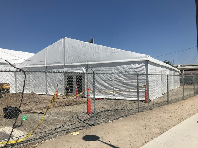 Work is being done on a temporary homeless shelter on East Fourth Street.