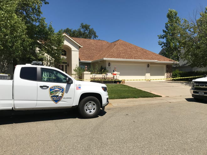 Police tape is seen Tuesday, Aug. 4, 2020 around a home in the 1600 block of Spanish Bay Drive in north Redding.
