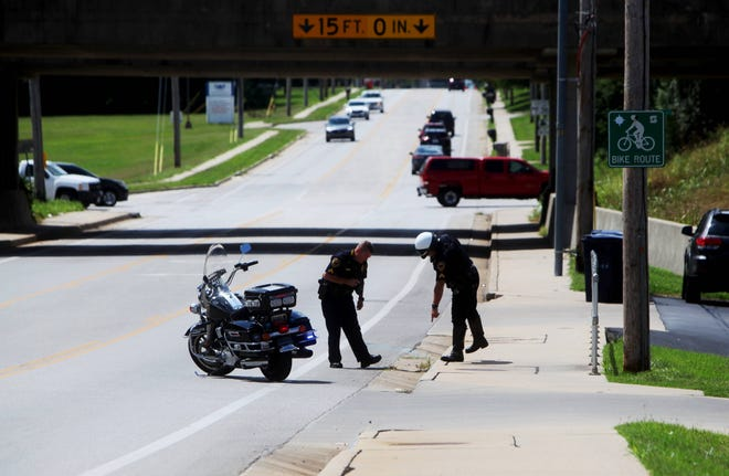 Springfield Police Department officers look for shell casings after a shooting near Norton Road and National Avenue Tuesday, Aug. 4, 2020.