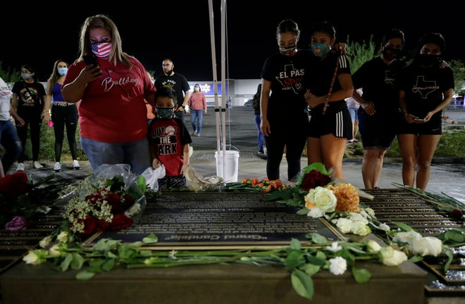 As Aug. 3, 2020, came to an end, El Pasoans flocked to the Grand Candela memorial in the parking lot of the Walmart where 23 people were murdered last year.
