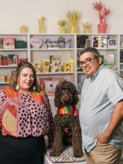 Ginger and Mario Diaz with their dog, Frida