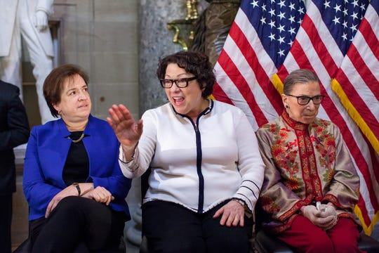 Supreme Court Justices Elena Kagan, Sonia Sotomayor and Ruth Bader Ginsburg, participate in an annual Women's History Month reception on Capitol Hill in Washington, D.C. Ginsburg died in September 2020 and was replaced by Justice Amy Coney Barrett.