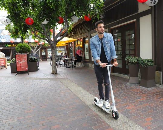 Riding along on a Unagi e-scooter