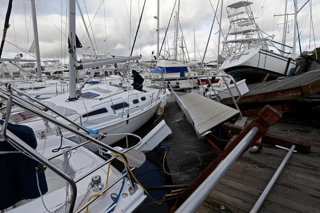 Boats are piled on each other in a marina following the effects of Hurricane Isaias in Southport, N.C., on Tuesday.