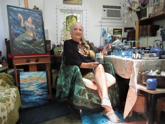 Artist Linda Olsen is pictured in her Neptune Beach studio.