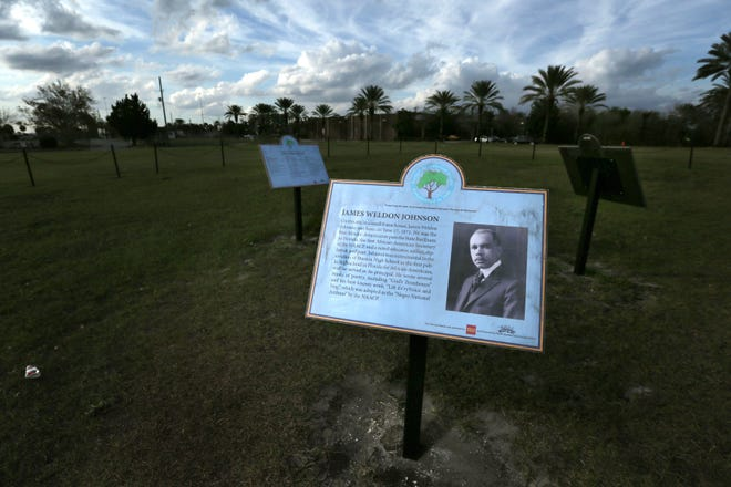 An informational sign about James Weldon Johnson at Lift Ev'ry Voice and Sing park on a vacant lot at the corner of Huston and Lee Street in what used to be the LaVilla neighborhood. The small chain wrapped lot is where the home that was the birthplace of James Weldon Johnson and his brother John Rosamond Johnson used to stand.