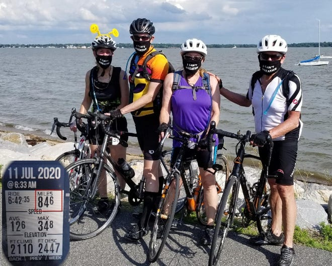 From left: Susan Epstein, David Epstein, Lynn Shapira and Nadiv Shapira at Battery Park after finishing their over 84-mile ride.
