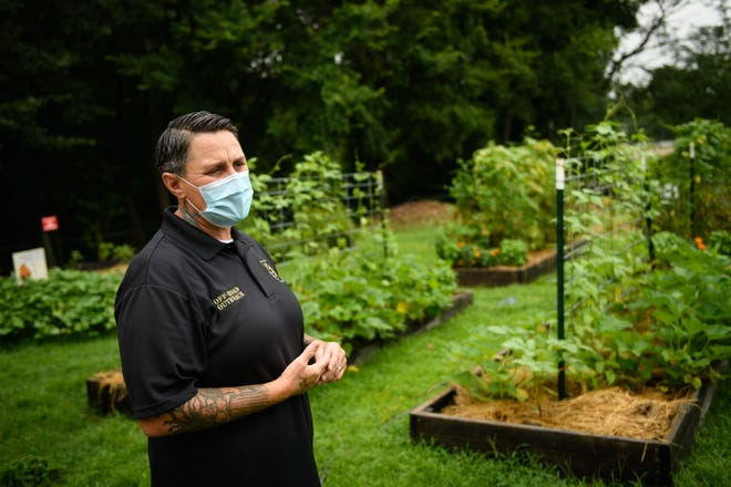 Stacey Buckner talks about the Veggies for Vets garden on July 30. Local nonprofits Off-Road Outreach and ServiceSource started the community garden for homeless, at-risk and low-income veterans.