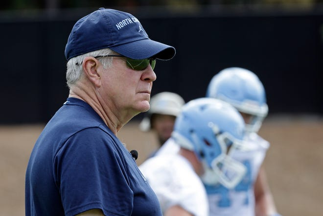 North Carolina coach Mack Brown oversees a preseason football practice last August.