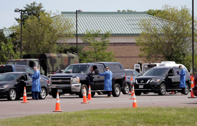Long lines are on hand at a community COVID-19 testing site at the University of Wisconsin-Oshkosh, Fox Cities Campus Wednesday, August 5, 2020, in Menasha, Wis.