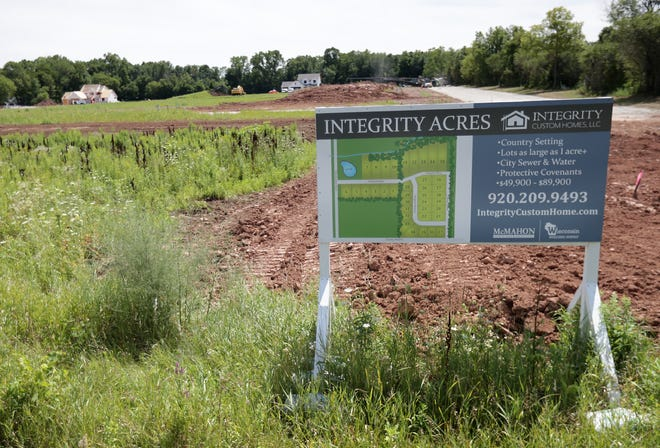 Contractors are building homes in the Integrity Acres subdivision south of Winnebago County G in Neenah. The city recently purchased 130 acres north of County G for development as single-family homes.
