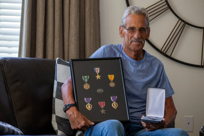Bart Fabian, who recently was awarded a second Silver Star for heroism as a medic in Vietnam -- 51 years after the act, talks about his time in Vietnam at his home in Aberdeen, NJ Wednesday, August 5, 2020. He framed his first Silver Star, two Purple Hearts, two Bronze Stars, Army Commendation for Valor medal and a Combat Medic Badge.