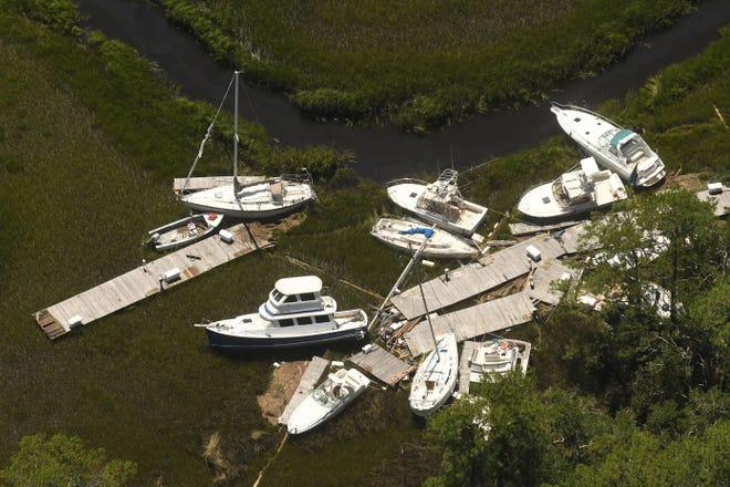Boats and docks are washed together along the marsh near Southport, N.C. as Hurricane Isaias came ashore late Monday Aug. 3, 2020 in Brunswick County as a category 1 hurricane  [KEN BLEVINS/STARNEWS]