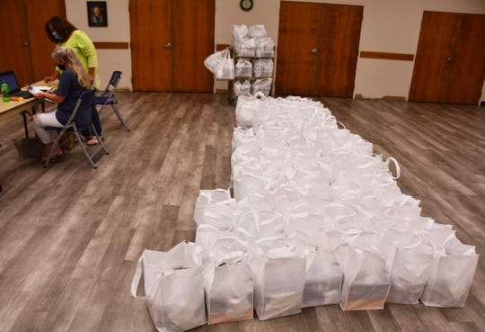 Bags filled with masks, gloves and hand sanitizer await distribution to small businesses during a recent county-organized event at the Cocoa Beach Public Library. Money for the supplies came from the federal Coronavirus Aid, Relief and Economic Security Act.