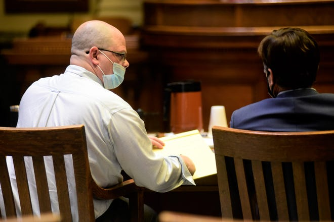 Jason Tupps consults with his attorney, James J. Mayer III, Tuesday during his jury trial in Crawford County.