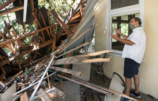 Jim Donio inspects his damaged Hammonton home on Wednesday, August 5, 2020, the day after Tropical Storm Isaias caused a tree to fall onto his home.