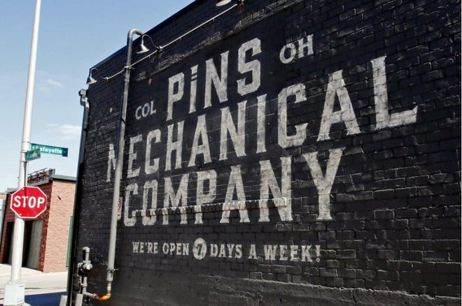 The exterior of Pins Mechanical Company, one of several Columbus bars and restaurants that on Wednesday, Aug. 5, 2020 unsuccessfully sought a temporary restraining order against the state Liquor Control Commission's emergency 10 p.m. halt to liquor sales and 11 p.m. end to liquor consumption on premises. Gov. Mike DeWine asked the commission for the order to slow down the COVID-19 pandemic in Ohio. The lawsuit filed by the bar and restaurant owners continues.