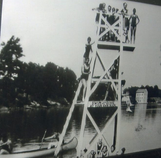 A crowded diving platform stood in the river in the 1920s.