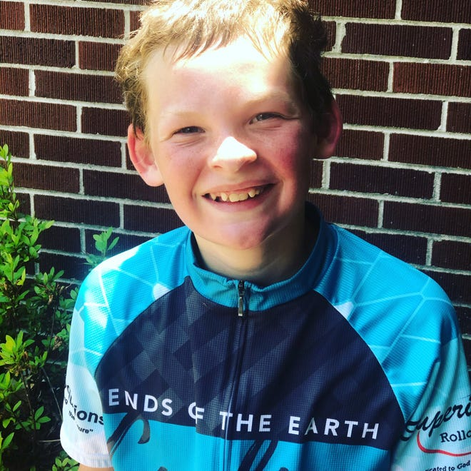 Levi Crosson, 11 and of Union City, Tennessee, receives a new bike from Bike Bistro of Fort Myers for his Ends of the Earth Cycling fundraising.