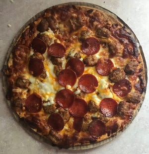 Meat Sweats Pothole Pizza is a combination pepperoni and sausage frozen pizza from Kwik Trip.