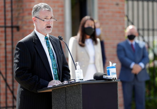 Stephen Murley, Green Bay Area Public School District superintendent, speaks about coming together as a community to curb the spread of coronavirus so schools can fully reopen during a press conference in front of City Stadium at Green Bay East High School on Aug. 5, 2020, in Green Bay, Wis.