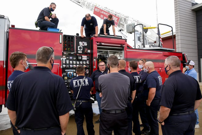 Matt Timmer, apparatus training coordinator with Fire Service Inc., talks through the pumping system on the Quint 1503 to the West Lafayette Fire Department, Wednesday, Aug. 5, 2020 in West Lafayette.