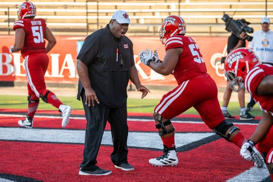 UL assistant football coach D.J. Looney runs drills with his players before the Ragin' Cajuns take on the Texas Southern Tigers at Cajun Field on September 14, 2019.