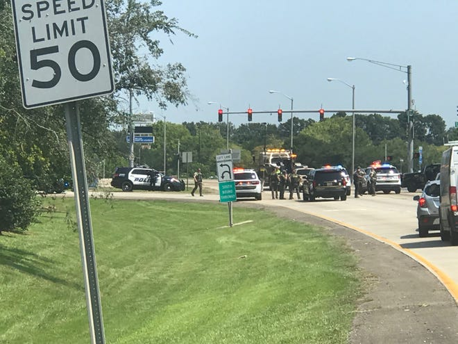 The Lafayette Parish Sheriff's Office negotiates with a man who barricaded himself in a truck on Aug. 5, 2020, on Evangeline Thruway near Willow Street.