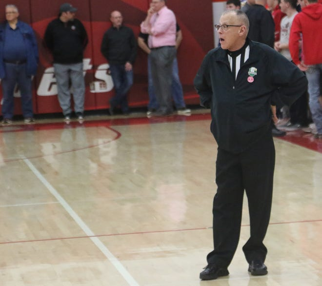 Veteran basketball official Dave Hackedorn awaits the tip of a basketball game at Shelby High School during the 2019-20 season.