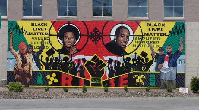 A Black Lives Matter mural in West Allis, painted in part by a teacher and current and former students at Milwaukee Lutheran High School, has sparked a debate about race and racism at the school.
