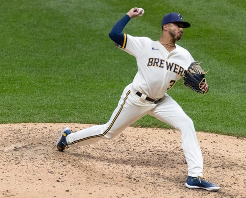 Brewers relief pitcher Devin Williams throws during the seventh inning.