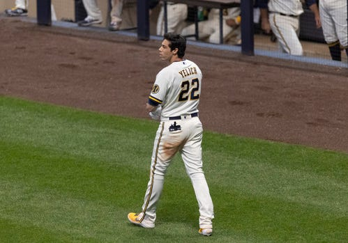 The Brewers' Christian Yelich is dejected after striking out to end the eighth inning.