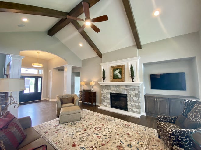 The Aspen homes Inc. model home, in the AeroPark Subdivision in Menomonee Falls, has a great room with a cathedral ceiling, and the beams carry through to the outside.