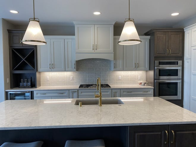 Oversized kitchens with islands can be gathering spots, as shown in the Aspen Homes model, at  AeroPark in Menomonee Falls.