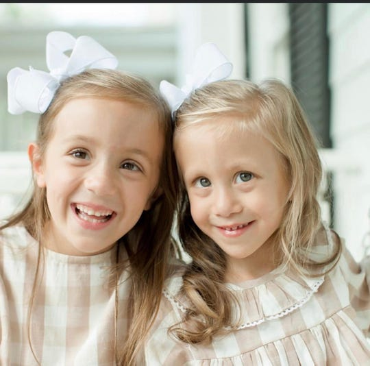 Anne Marie Calligas, right, with her big sister Isabel Calligas.