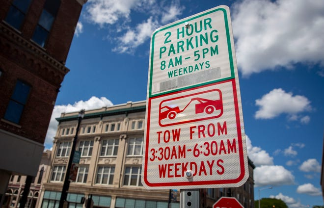 Parking signs remind drivers along downtown streets that there are two hour time limits for street parking. The Muncie Police Department is asking the city council to consider changes to parking enforcement codes, allowing them to boot drivers with unpaid tickets.