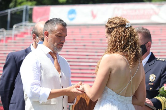 Janet Fenner and Greg Dabice were married at the 50-yard-line at Montclair State University on August 1, 2020, 28 years after they were crowned homecoming king and queen in the same spot.