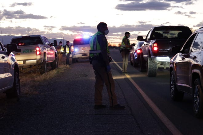 The Navajo Police Department conducts a checkpoint in Hogback on April 1 to share information about the curfew order on the Navajo Nation.