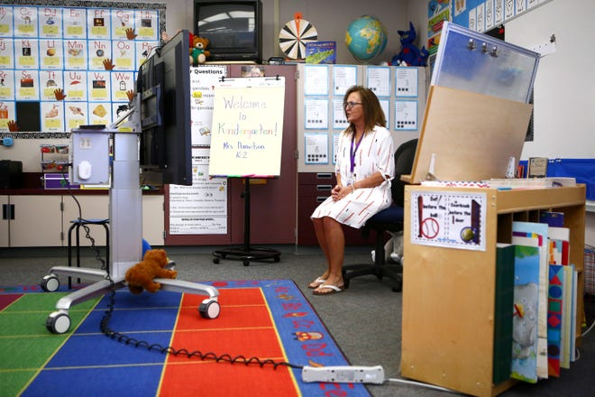 Landau Elementary School kindergarten teacher Marci Danielson gives live instruction during Palm Springs Unified School Districts' first day of distance learning in Cathedral City, Calif., on Wednesday, August 5, 2020.
