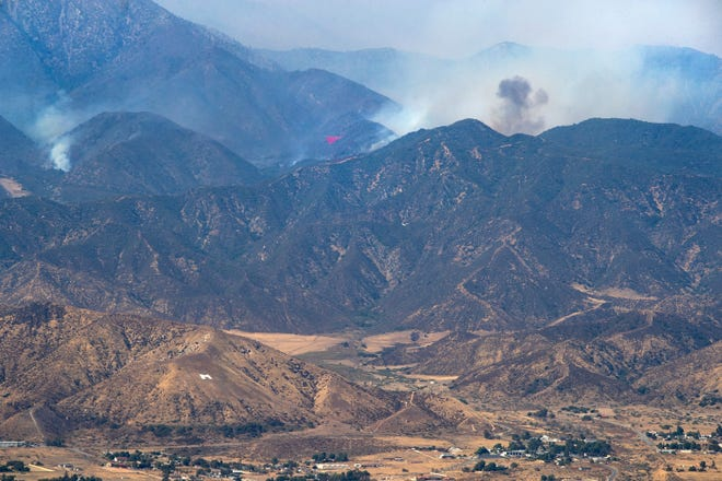 Smoke from the Apple Fire burning in the wilderness to the north of the Morongo Band of Mission Indians reservation can be seen from Highway 243 near Cabazon, Calif., on Tuesday, August 4, 2020.