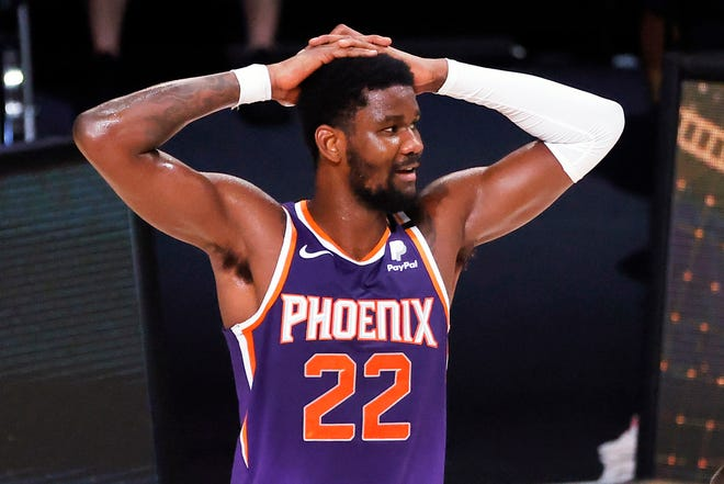 Phoenix Suns' Deandre Ayton reacts after being charged with a foul during an NBA basketball game against the Los Angeles Clippers in Lake Buena Vista, Fla., on Aug. 4, 2020.