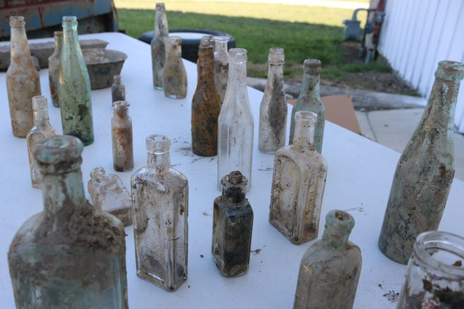 Port Clinton city workers have been uncovering a plethora of old glass bottles as they dig up a section of Jefferson Street.