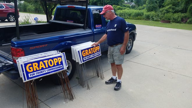 St. Clair County Commissioner Bill Gratopp sifts through signs on Wednesday, Aug. 5, 2020, after he spent much of that morning picking them up from around his district. Gratopp, who's served on the county board for a decade, lost his primary Tuesday to Marine City Mayor Dave Vandenbossche.