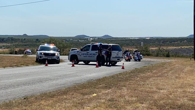 San Angelo police block off Mercedes Road near O.C. Fisher Dam during a chase in progress around 4:30 p.m. Wednesday, Aug. 5, 2020.
